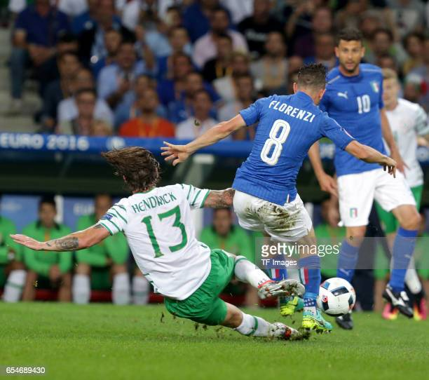 Jeff Hendrick of Ireland and Alessandro Florenzi of Italy battle for the ball during the UEFA Euro 2016 Group E match between Italy and Republic of...
