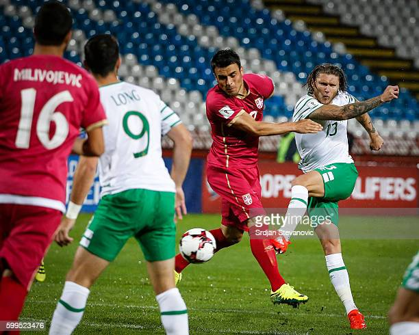 Jeff Hendrick of Ireland scores the goal near Filip Kostic of Serbia during the FIFA 2018 World Cup Qualifier between Serbia and Ireland at stadium...