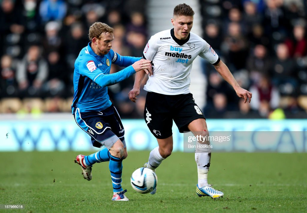 Jeff Hendrick of Leeds holds off the challenge of Paul Green of Leeds during the npower Championship match between Derby County and Leeds United at Pride Park on December 8, 2012 in Derby, England.