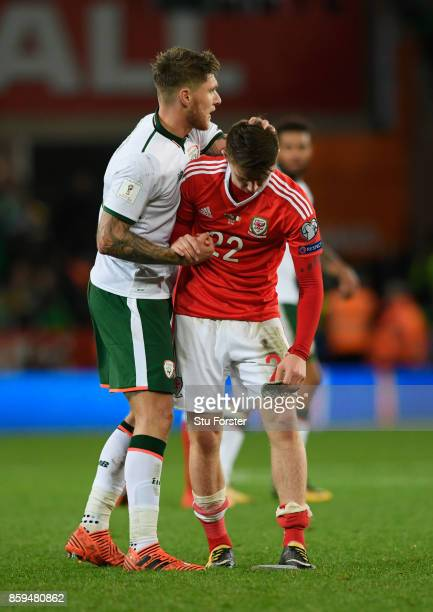 Jeff Hendrick of the Republic of Ireland consoles Ben Woodburn of Wales after the FIFA 2018 World Cup Group D Qualifier between Wales and Republic of...