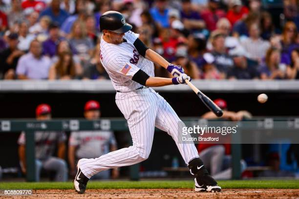 Jeff Hoffman of the Colorado Rockies singles in the sixth inning of a game against the Cincinnati Reds at Coors Field on July 3 2017 in Denver...