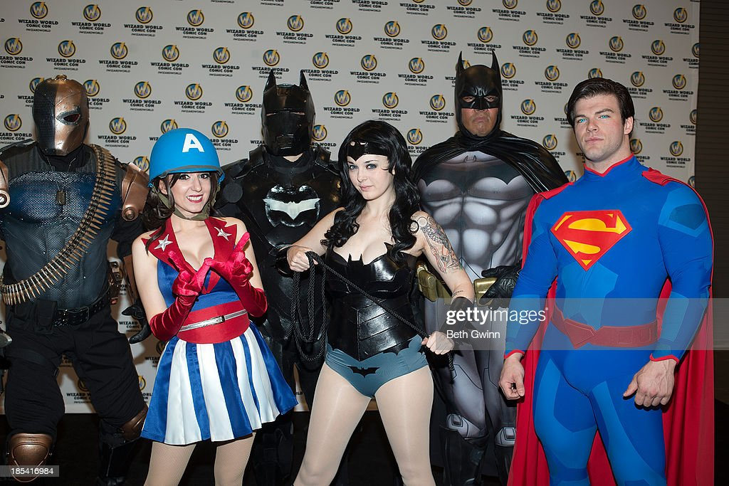 Jeff Holland, Riki Lecotey, Adam Prince, Elizabeth Wither, Eric Moran, and Jonathan Carroll as Deathstoke, USO Captain America dancer, Dark Knight, Batgirl, Batman, Superman attends Nashville Comic Con 2013 at Music City Center on October 19, 2013 in Nashville, Tennessee.