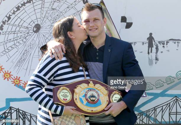 Jeff Horn and wife Jo pose for the media with his WBO World Welterweight belt during a media opportunity at South Bank Parklands on July 3 2017 in...