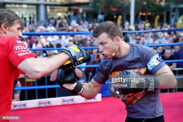 Jeff Horn hits the pads with trainer Glenn Rushton during a training session at Reddacliff Place on June 29 2017 in Brisbane Australia