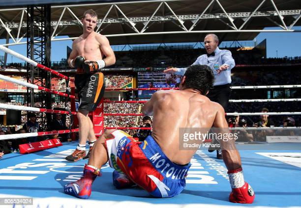 Jeff Horn is seen looking over Manny Pacquiao after he slips over during the WBO Welterweight Title Fight between Jeff Horn of Australia and Manny...