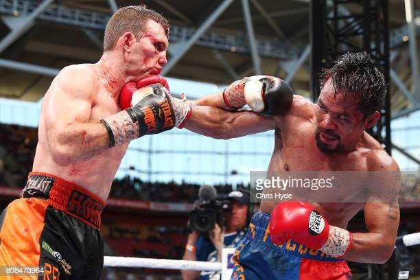 Jeff Horn of Australia and Manny Pacquiao exchange punches during the WBO World Welterweight Title Fight at Suncorp Stadium on July 2 2017 in...