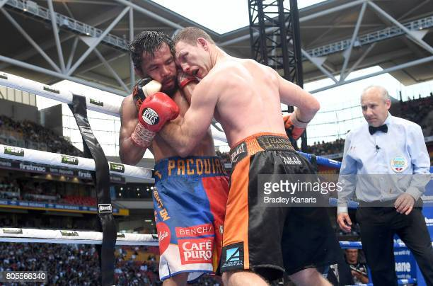 Jeff Horn of Australia and Manny Pacquiao grapple during the WBO Welterweight Title Fight between Jeff Horn of Australia and Manny Pacquiao of the...