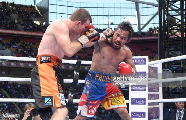 Jeff Horn of Australia and Manny Pacquiao throw punches during the WBO Welterweight Title Fight between Jeff Horn of Australia and Manny Pacquiao of...