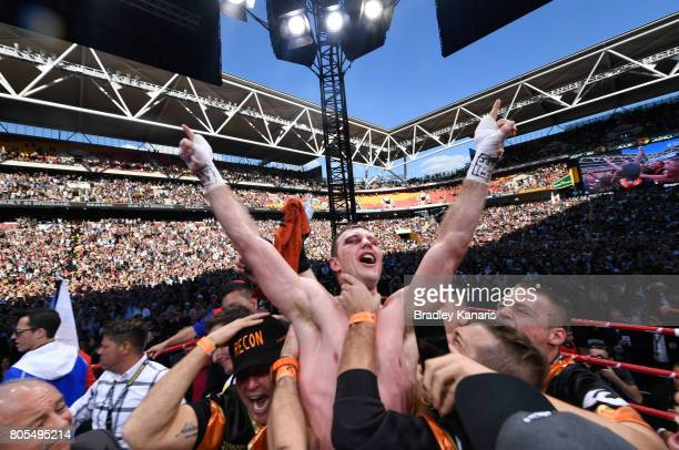 Jeff Horn of Australia celebrates beating Manny Pacquiao of the Philippines in their WBO welterweight championship title fight at Suncorp Stadium on...