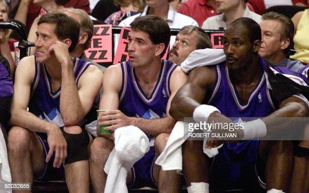 Jeff Hornacek John Stockton and Karl Malone of the Utah Jazz watch the final seconds of game three of their Western Conference semifinal against the...