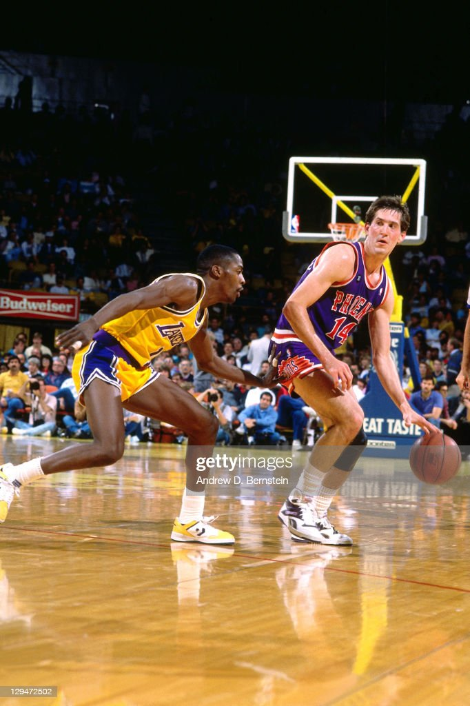 Jeff Hornacek of the Phoenix Suns dribbles against Byron Scott of the Los Angeles Lakers circa 1987 at the Great Western Forum in Inglewood...