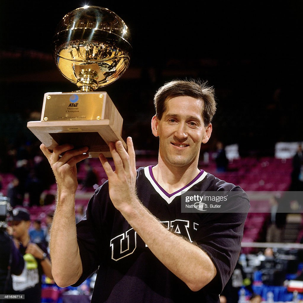Jeff Hornacek of the Utah Jazz hoists the trophy following the three point contest as part of NBA AllStar Weekend on February 7 1998 at Madison...