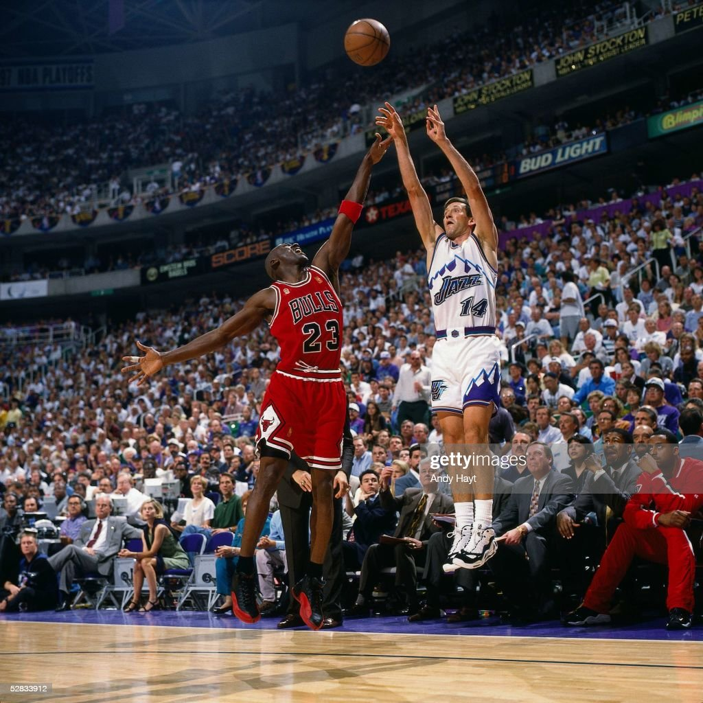 Jeff Hornacek of the Utah Jazz takes a jumper over Michael Jordan of the Chicago Bulls during game five of the 1997 NBA Finals at the Delta Center on...
