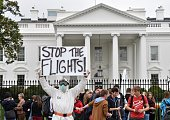 Jeff Hulbert from Annapolis Maryland dressed in a protective suit and mask holds a poster demanding for a halt of all flights from West Africaas he...