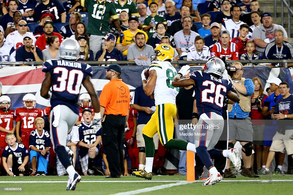<a gi-track='captionPersonalityLinkClicked' href=/galleries/search?phrase=Jeff+Janis&family=editorial&specificpeople=12427533 ng-click='$event.stopPropagation()'>Jeff Janis</a> #83 of the Green Bay Packers catches a touchdown in the second quarter against <a gi-track='captionPersonalityLinkClicked' href=/galleries/search?phrase=Logan+Ryan&family=editorial&specificpeople=8222226 ng-click='$event.stopPropagation()'>Logan Ryan</a> #26 of the New England Patriots during a preseason game at Gillette Stadium on August 13, 2015 in Foxboro, Massachusetts.