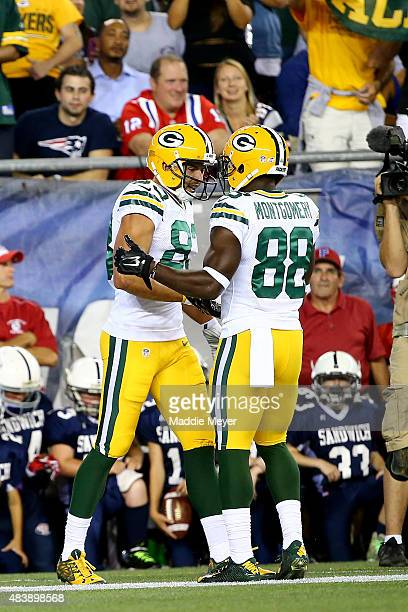Jeff Janis of the Green Bay Packers celebrates with Ty Montgomery after scoring a touchdown in the second quarter against the New England Patriots...