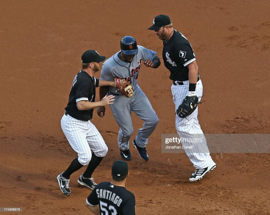 <a gi-track='captionPersonalityLinkClicked' href=/galleries/search?phrase=Jeff+Keppinger&family=editorial&specificpeople=835796 ng-click='$event.stopPropagation()'>Jeff Keppinger</a> #7 of the Chicago White Sox apparently tags out <a gi-track='captionPersonalityLinkClicked' href=/galleries/search?phrase=Torii+Hunter&family=editorial&specificpeople=183408 ng-click='$event.stopPropagation()'>Torii Hunter</a> #48 of the Detroit Tigers in a 1st inning run-down but <a gi-track='captionPersonalityLinkClicked' href=/galleries/search?phrase=Adam+Dunn&family=editorial&specificpeople=213505 ng-click='$event.stopPropagation()'>Adam Dunn</a> #32 (R) is called for interference at U.S. Cellular Field on July 23, 2013 in Chicago, Illinois.