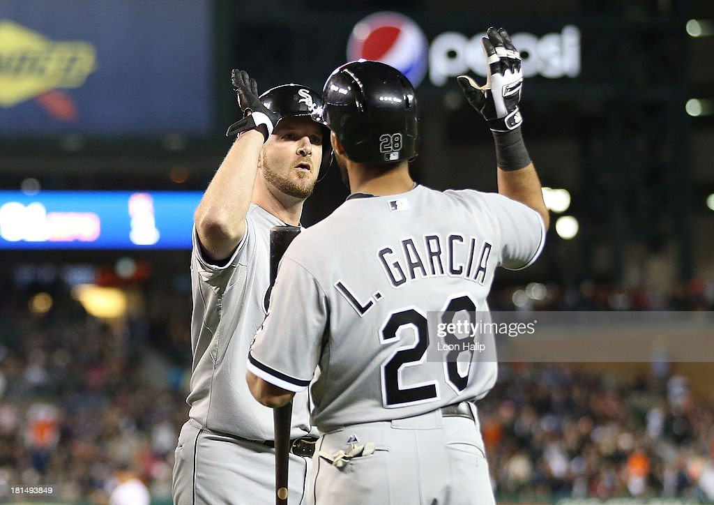 <a gi-track='captionPersonalityLinkClicked' href=/galleries/search?phrase=Jeff+Keppinger&family=editorial&specificpeople=835796 ng-click='$event.stopPropagation()'>Jeff Keppinger</a> #7 of the Chicago White Sox celebrates with teammate Leury Garcia #28 after scoring on the double by Bryan Anderson #39 in the ninth inning of the game against the Detroit Tigers at Comerica Park on September 21, 2013 in Detroit, Michigan.