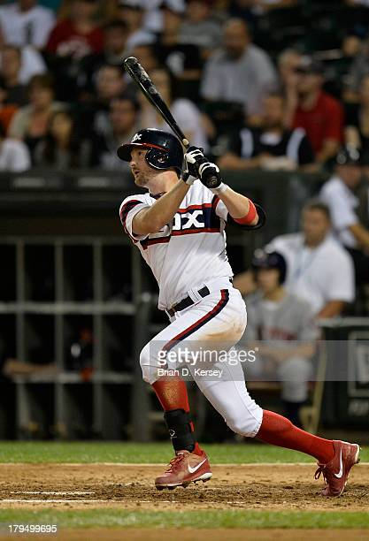 Jeff Keppinger of the Chicago White Sox follows through on a sacrifice fly scoring teammate Leury Garcia during the seventh inning against the...