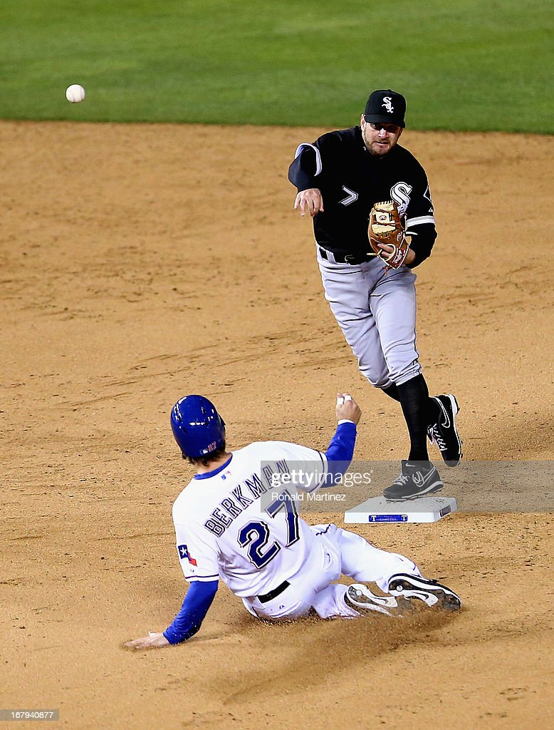 Jeff Keppinger #7 of the Chicago White Sox makes the out against Lance Berkman #27 of the Texas Rangers at Rangers Ballpark in Arlington on May 2, 2013 in Arlington, Texas.