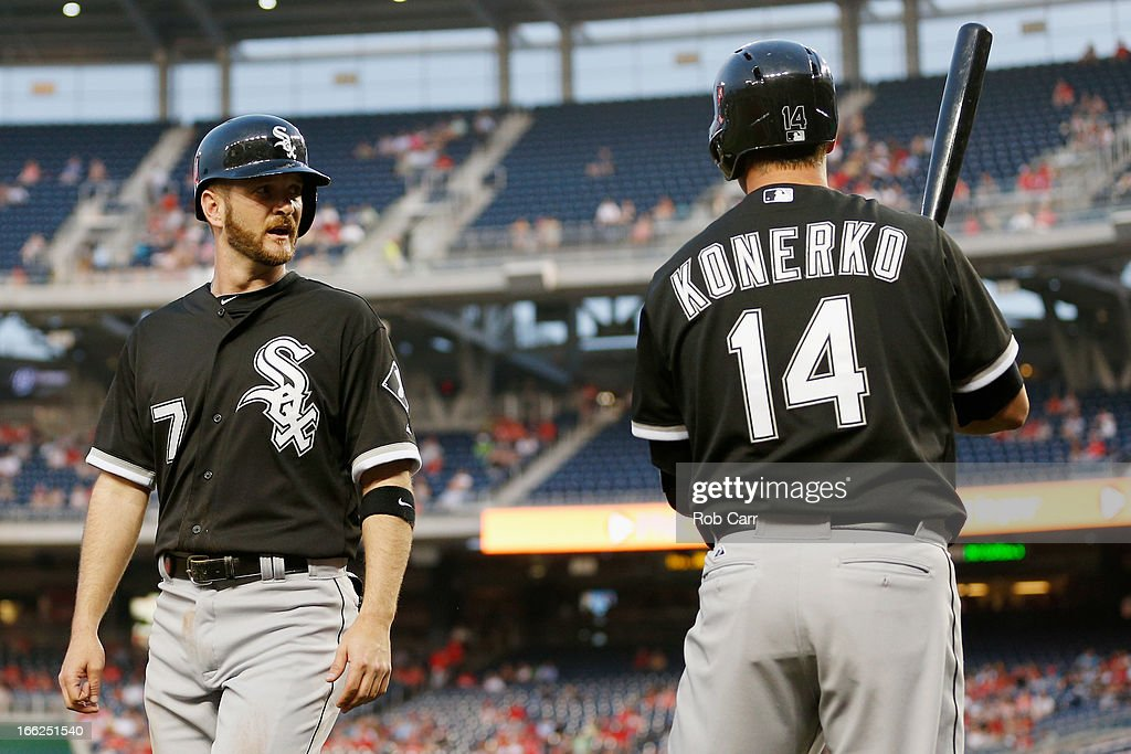 <a gi-track='captionPersonalityLinkClicked' href=/galleries/search?phrase=Jeff+Keppinger&family=editorial&specificpeople=835796 ng-click='$event.stopPropagation()'>Jeff Keppinger</a> #7 of the Chicago White Sox talks with <a gi-track='captionPersonalityLinkClicked' href=/galleries/search?phrase=Paul+Konerko&family=editorial&specificpeople=203327 ng-click='$event.stopPropagation()'>Paul Konerko</a> #14 after scoring a run during the first inning against the Washington Nationals at Nationals Park on April 10, 2013 in Washington, DC.