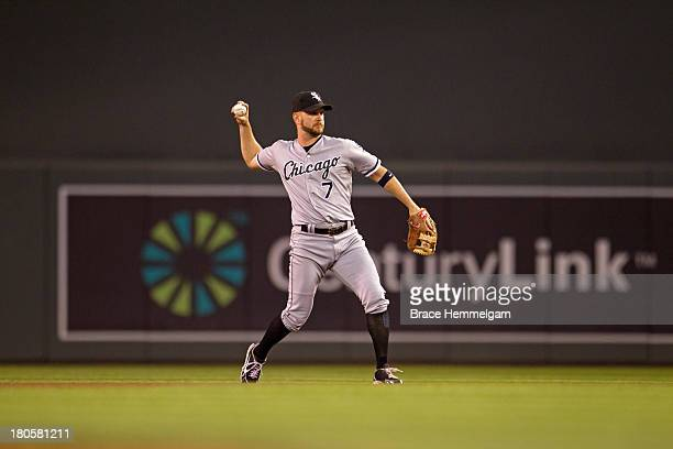 Jeff Keppinger of the Chicago White Sox throws against the Minnesota Twins on August 16 2013 at Target Field in Minneapolis Minnesota The White Sox...