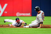 Jeff Keppinger of the San Francisco Giants slides safely in to second base against Dan Uggla of the Atlanta Braves at Turner Field on August 15 2011...