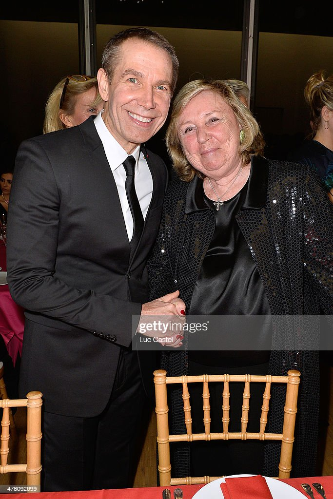 Jeff Koons and Miss Francois Pinault attend the 'Societe des amis du Musee D'Art Moderne' : Annual Dinner. Held at Centre Pompidou on March 11, 2014 in Paris, France.