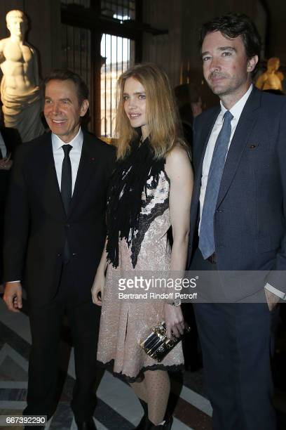Jeff Koons Antoine Arnault and Natalia Vodianova attend the 'LVxKOONS' exhibition at Musee du Louvre on April 11 2017 in Paris France