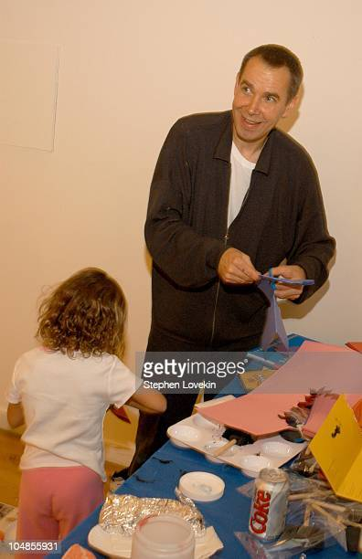 Jeff Koons helps out the kids during Children's Day Artrageous Hosted by The Edwin Gould Foundation at The Metropolitan Pavillion in New York City NY...