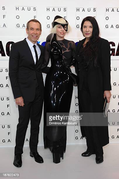 Jeff Koons Lady Gaga and Marina Abramovic attend the 'Lady Gaga Presents 'artRave' event at Brooklyn Navy Yard on November 10 2013 in the Brooklyn...