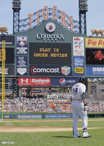 Jeff Larish of the Detroit Tigers awaits the decision on his 2run homer in the first ever instant replay at Comerica Park during the game against the...
