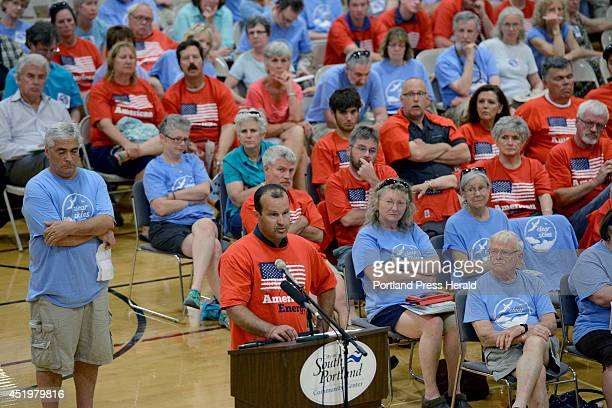 Jeff Leary from South Portland in a red shirt speaks as a large crowd showed up at a South Portland City Council meeting to discuss a proposed...