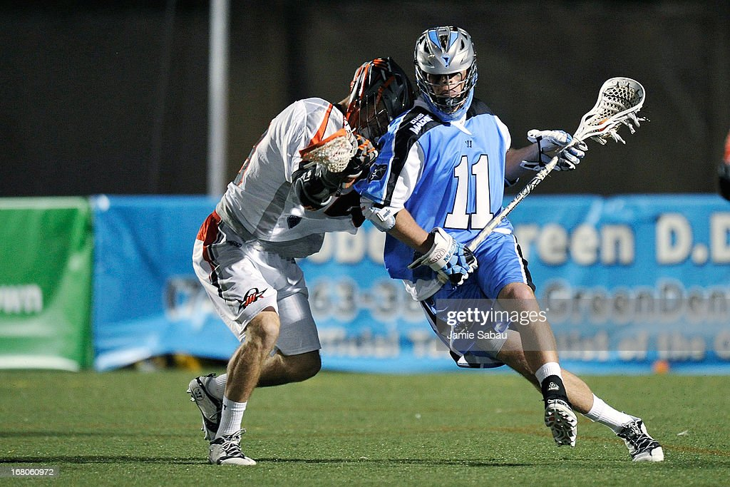 Jeff Ledwick #11 of the Ohio Machine controls the ball in the second half as Drew Snider #23 of the Denver Outlaws defends on May 4, 2013 at Selby Stadium in Delaware, Ohio.