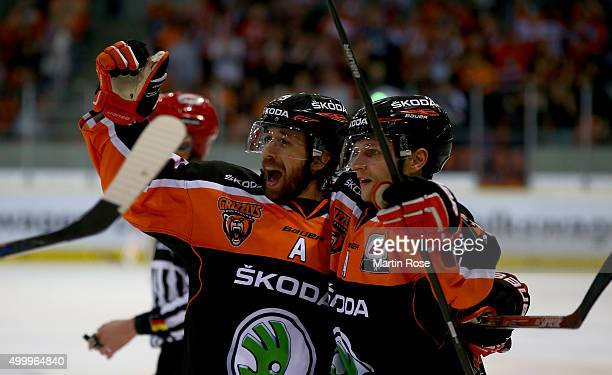 Jeff Likens of Wolfsburg celebrate with team mate Sebastian Furchner during the DEL match between Grizzly Adams Wolfsburg and Koelner Haie at BraWo...
