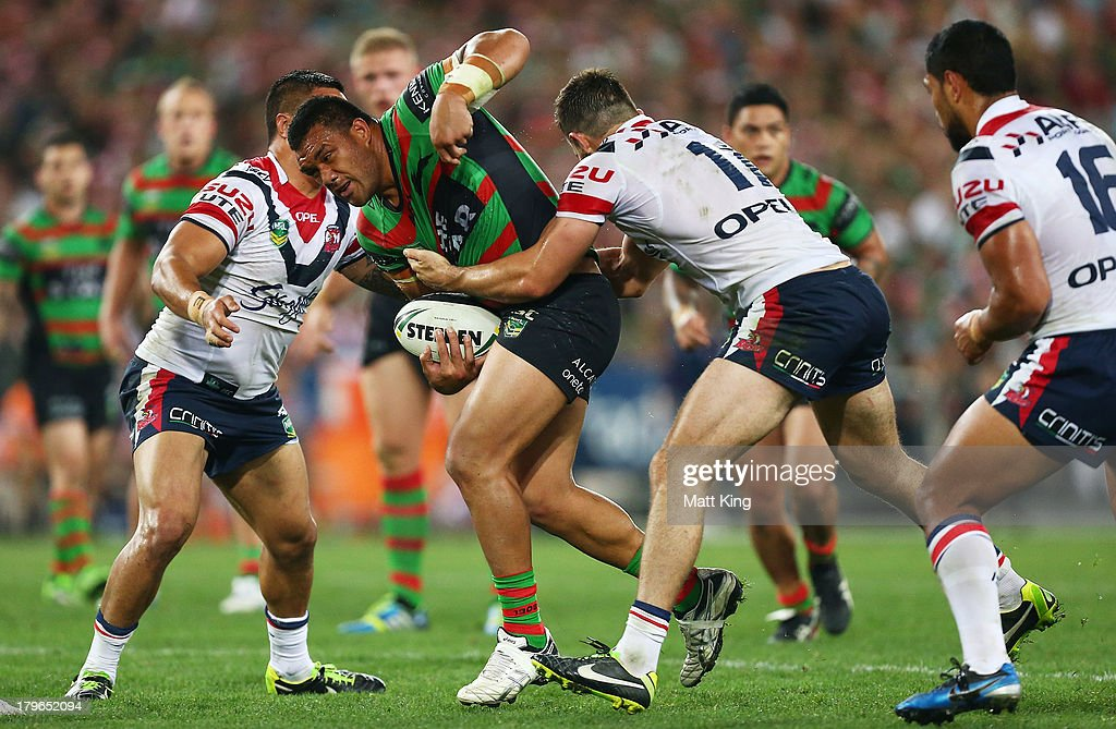 Jeff Lima of the Rabbitohs is tackled during the round 26 NRL match between the South Sydney Rabbitohs and the Sydney Roosters at ANZ Stadium on September 6, 2013 in Sydney, Australia.