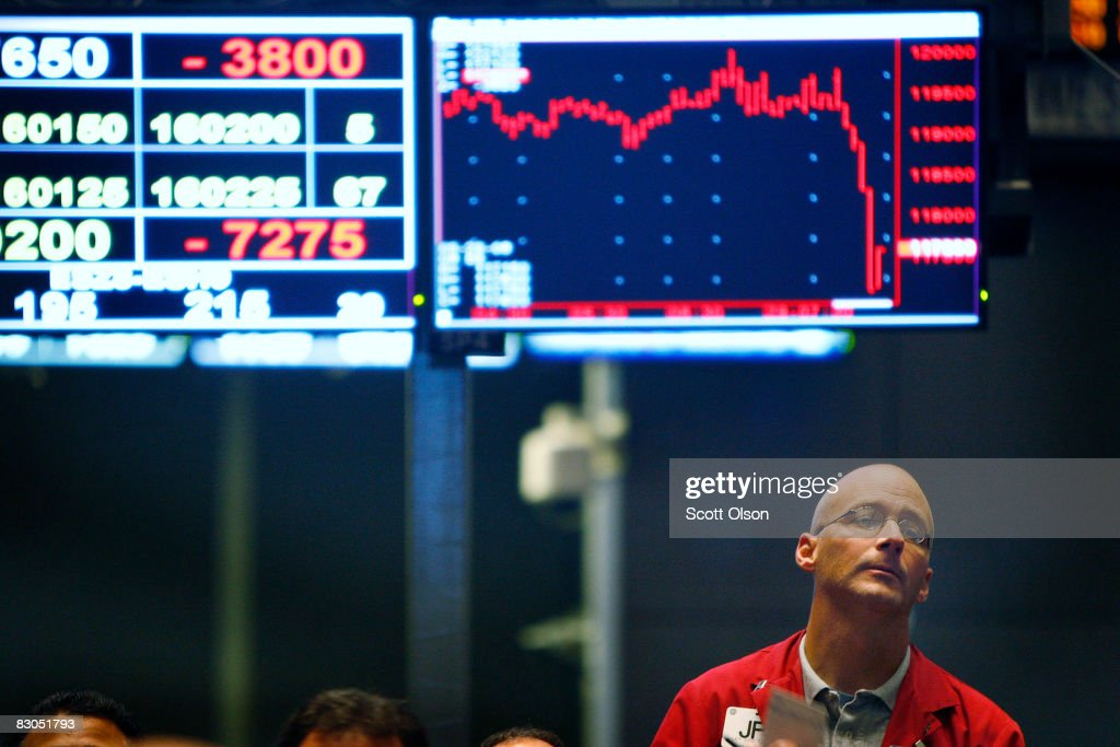 Jeff Linforth stands at the Chicago Board of Trade signal offers in the Standard Poors stock index futures pit near the open of trading September 29...