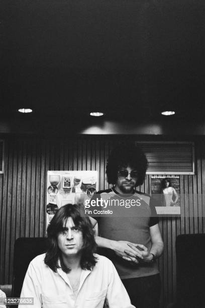 Jeff Lynne of British rock group Electric Light Orchestra also known as ELO in the background behind producer Reinhold Mack in a studio in Germany...