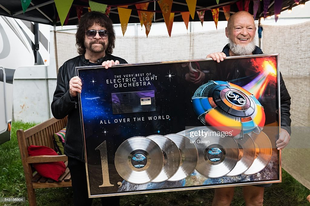 Jeff Lynne of ELO and Michael Eavis pose backstage with a commemorative disc for the album 'All Over the World' on day 3 of the Glastonbury Festival at Worthy Farm, Pilton on June 26, 2016 in Glastonbury, England. Now its 46th year the festival is one largest music festivals in the world and this year features headline acts Muse, Adele and Coldplay. The Festival, which Michael Eavis started in 1970 when several hundred hippies paid just £1, now attracts more than 175,000 people.