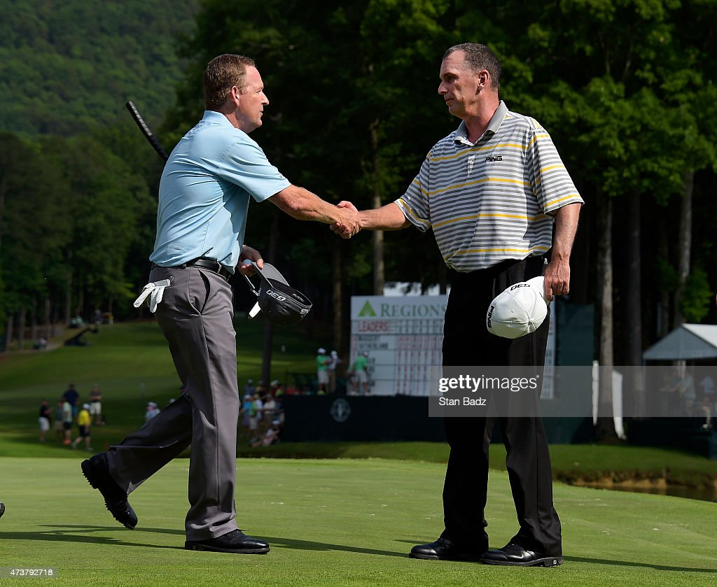 Jeff Maggert and Kevin Sutherland shake hands before heading for the first playoff on the 18th hole during the final round of the Champions Tour...