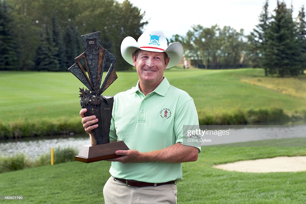 Jeff Maggert holds the trophy after winning the Shaw Charity Classic at the Canyon Meadows Golf Country Club on August 09 2015 in Calgary Canada