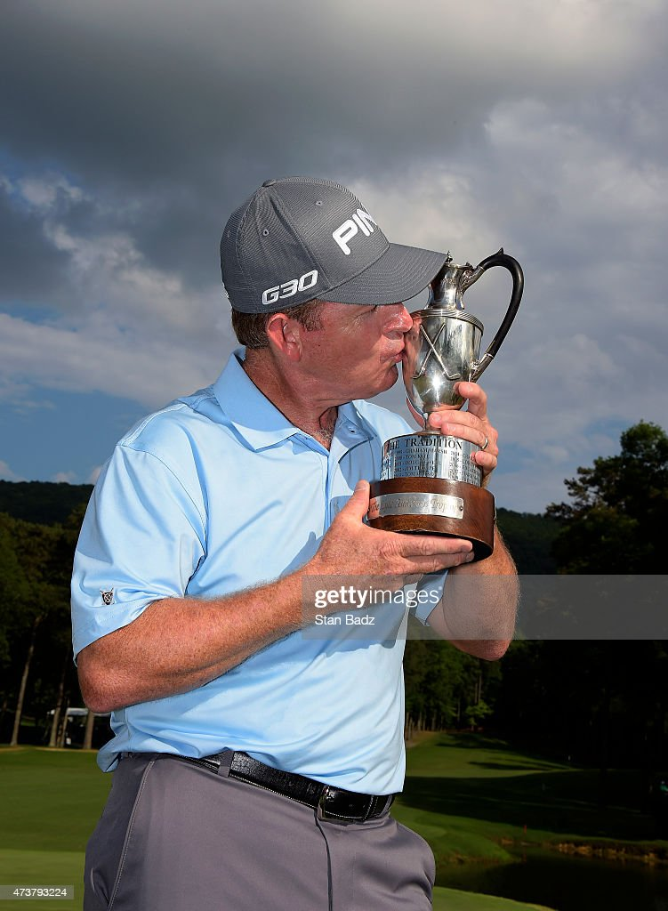 Jeff Maggert kisses the winner's trophy after the final round of the Champions Tour Regions Tradition at Shoal Creek on May 17 2015 in Shoal Creek...