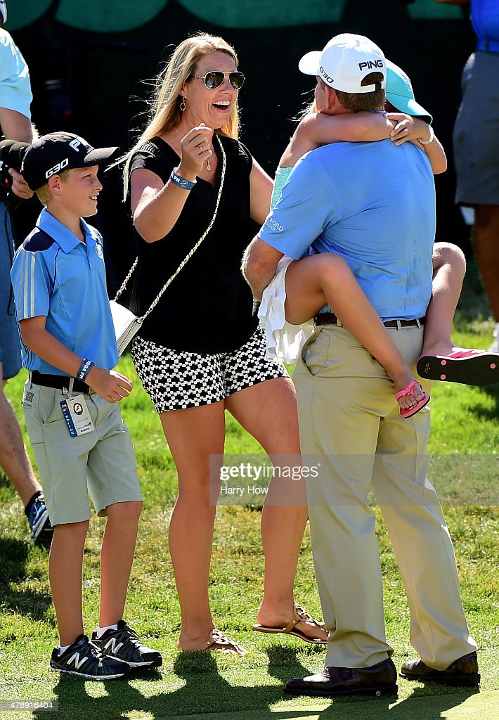 Jeff Maggert of the United States celebrates his win with his family on the 18th green during round four of the US Senior Open Championship at the...