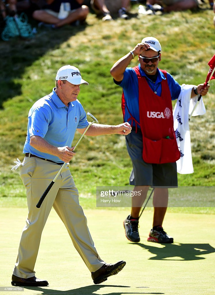Jeff Maggert of the United States reacts to his final putt for victory with caddie Rusty Uresti on the 18th green during round four of the US Senior...