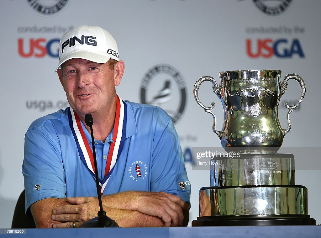 Jeff Maggert of the United States speaks to the media with the trophy at his side after round four of the US Senior Open Championship at the Del Paso...