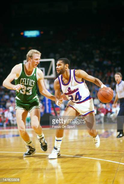 Jeff Malone of the Washington Bullets drives on Larry Bird of the Boston Celtics during an NBA basketball game circa 1987 at the Capital Centre in...