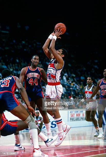 Jeff Malone of the Washington Bullets shoots over Rick Mahorn of the Detroit Pistons during an NBA basketball game circa 1985 at the Capital Centre...