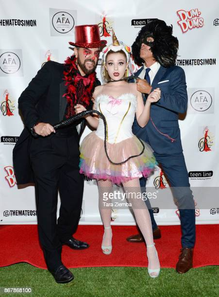 Jeff Marchelletta Madison McDermott and Paul Weber attend Mateo Simon's Halloween Charity Event on October 28 2017 in Burbank California
