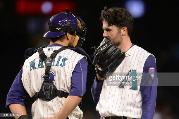 Jeff Mathis and Robbie Ray of the Arizona Diamondbacks talk during the sixth inning San Francisco Giants at Chase Field on April 6 2017 in Phoenix...