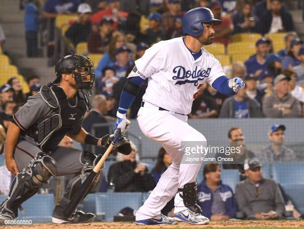 Jeff Mathis of the Arizona Diamondbacks looks on as Adrian Gonzalez of the Los Angeles Dodgers hits an RBI single scoring Corey Seager in the third...